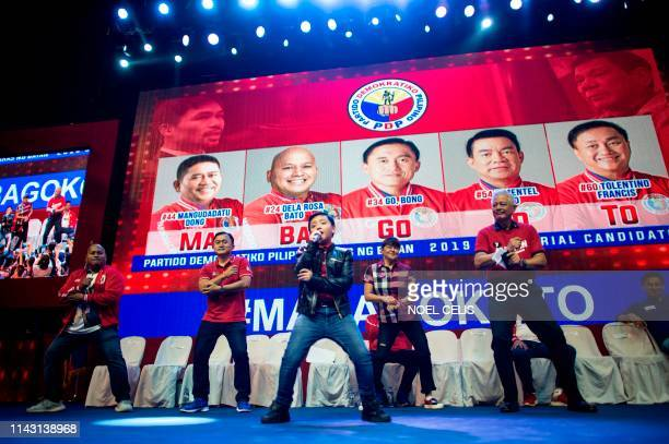 Imee Marcos daughter of the late Philippine dictator Ferdinand Marcos dances with other senatorial candidates during the Partido Demokratiko...