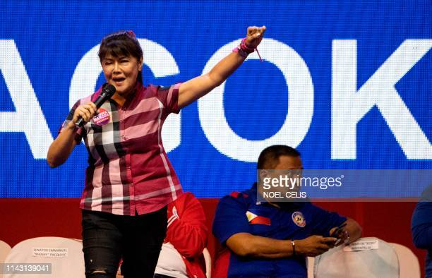 Imee Marcos daughter of the late Philippine dictator Ferdinand Marcos and senatorial candidate gestures during the Partido Demokratiko PilipinoLakas...