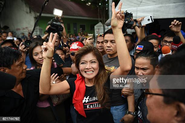 Imee Marcos daughter of the late Philippine dictator Ferdinand Marcos flashes the V sign as she celebrates with supporters during a rally in front of...