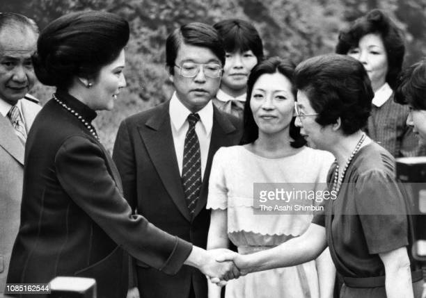 Imelda Marcos, wife of Philippines President Ferdinand Marcos, shakes hands with Shigeko Ohira, widow of late Prime Minister Masayoshi Ohira during...