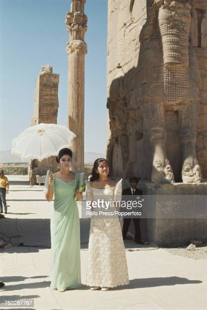 Imelda Marcos wife of president Ferdinand Marcos of the Philippines pictured with her daughter Imee Marcos as they tour the remains of Persepolis in...