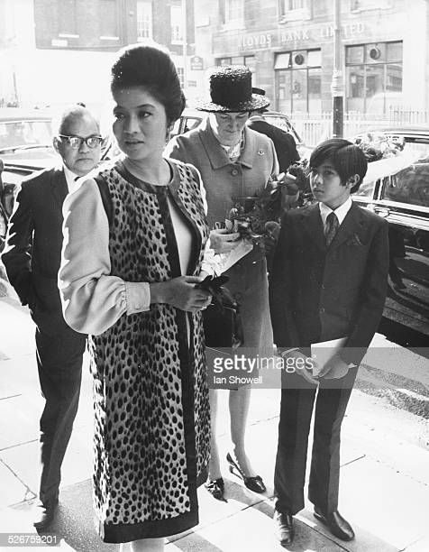 Imelda Marcos, wife of the President of the Philippines, with her son Ferdinand Jr, arriving at Claridge's Hotel, London, September 7th 1970.