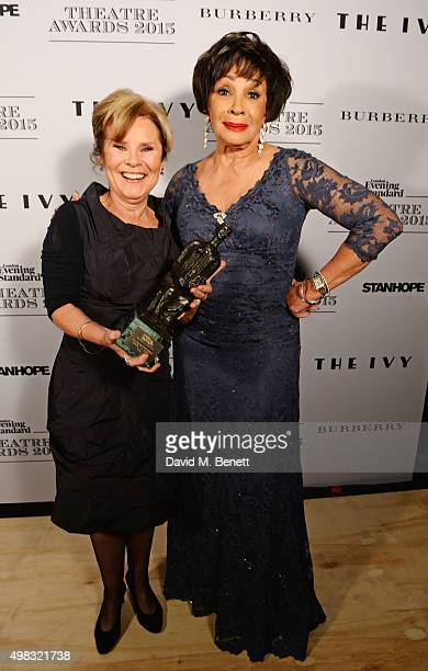 Imelda Staunton winner of the Best Musical Performance award and presenter Dame Shirley Bassey pose in front of the Winners Boards at The London...