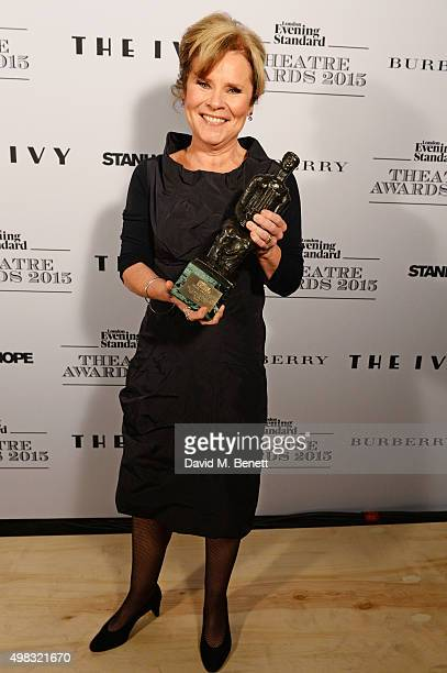 Imelda Staunton winner of the Best Musical Performance award poses in front of the Winners Boards at The London Evening Standard Theatre Awards in...