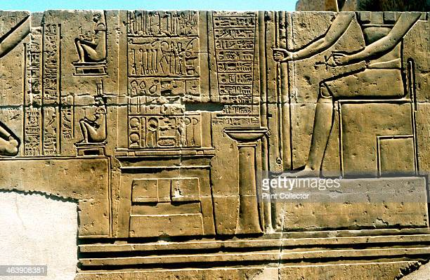 Imhotep Ancient Egyptian physician Limestone relief Imhotep is shown seated together with surgical instruments and a birthing chair Imhotep was...