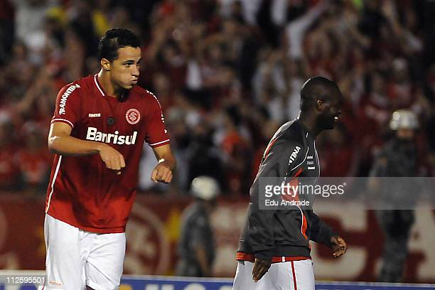 Imitating a motorcycle rider in honour to his brother, Leandro Damiao of Internacional celebrates his scored goal over Emelec during the match as...