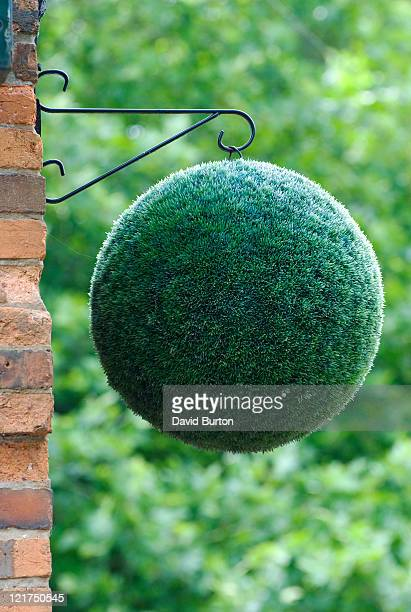 Imitation clipped yew hanging ball