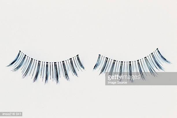 imitation eyelashes - false eyelash stock pictures, royalty-free photos & images