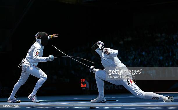 Imke Duplitzer of Germany competes against Maria Martinez of Venezuela during the Women's Epee Individual Fencing round of 64 on Day 3 of the London...