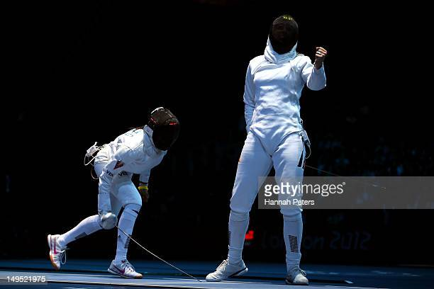 Imke Duplitzer of Germany reacts after a point against Maria Martinez of Venezuela during the Women's Epee Individual Fencing round of 64 on Day 3 of...