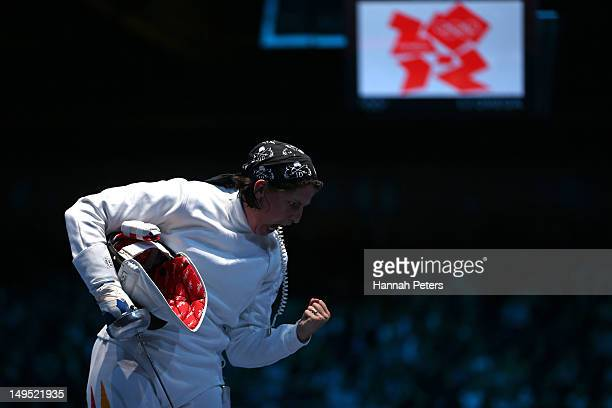 Imke Duplitzer of Germany reacts after point against Maria Martinez of Venezuela during the Women's Epee Individual Fencing round of 64 on Day 3 of...