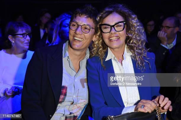 Imma Battaglia and Eva Grimaldi attend the Enzo Miccio show at Sposaitalia Collezioni on April 06 2019 in Milan Italy