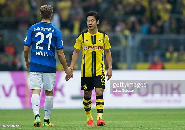 Immanuel Hoehn of Darmstadt and Shinji Kagawa of Dortmund shake hands after the Bundesliga match between Borussia Dortmund and SV Darmstadt 98 at...
