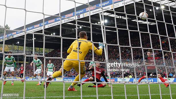 Immanuel Hoehn of Freiburg scores his team's first goal past goalkeeper Sebastian Mielitz of Fuerth during the Second Bundesliga match between SC...