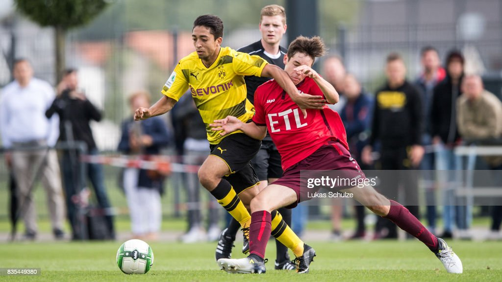Immanuel Pherai (L) of Dortmund and Can Karaguemrueklue (R) of Koeln fight for the ball during the B Juniors Bundesliga match between Borussia Dortmund and FC Viktoria Koeln on August 19, 2017 in Dortmund, Germany.