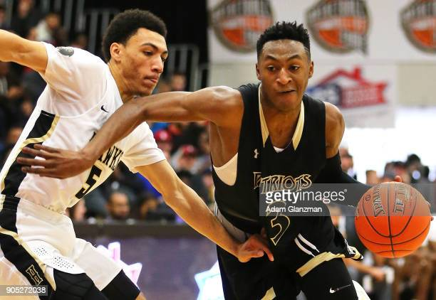 Immanuel Quickley of the John Carroll School dribbles past Jahvon Quinerly of Hudson Catholic High School during the 2018 Spalding Hoopall Classic at...