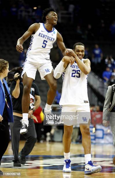 Immanuel Quickley of the Kentucky Wildcats celebrates with PJ Washington after defeating the Houston Cougars 6258 during the 2019 NCAA Basketball...