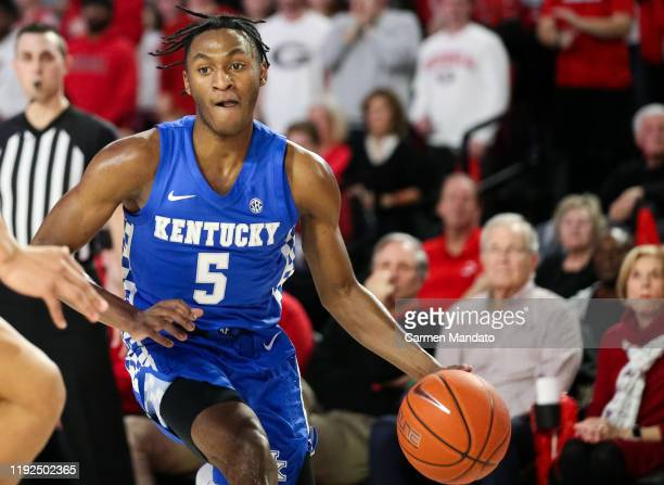 Immanuel Quickley of the Kentucky Wildcats controls the ball during the first half of a game against the Georgia Bulldogs at Stegeman Coliseum on...