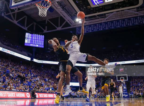 Immanuel Quickley of the Kentucky Wildcats shoots the ball against Mitchell Smith of the Missouri Tigers during the second half at Rupp Arena on...