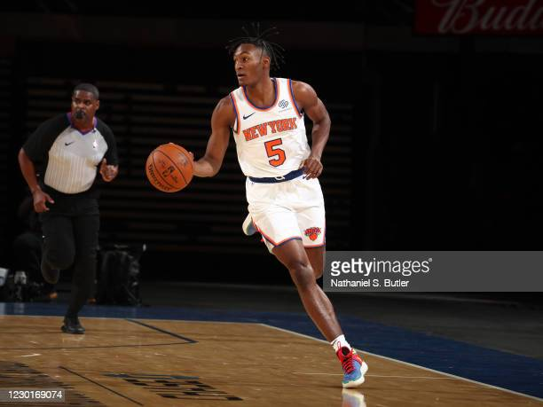 Immanuel Quickley of the New York Knicks bring the ball up court against the Cleveland Cavaliers on December 16, 2020 at Madison Square Garden in New...