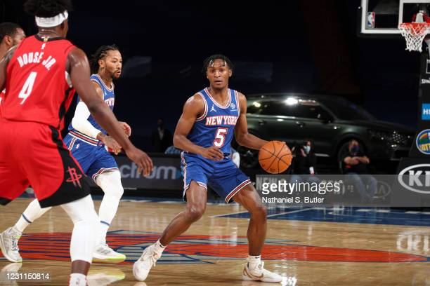 Immanuel Quickley of the New York Knicks dribbles during the game against the Houston Rockets on February 13, 2021 at Madison Square Garden in New...