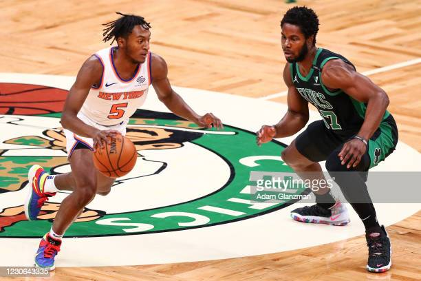 Immanuel Quickley of the New York Knicks dribbles past Semi Ojeleye of the Boston Celtics during a game at TD Garden on January 17, 2021 in Boston,...