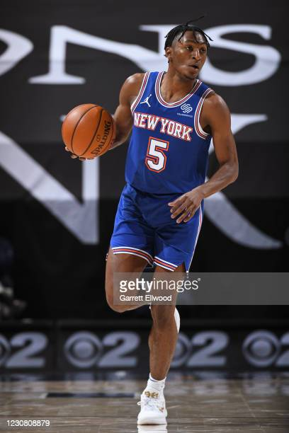 Immanuel Quickley of the New York Knicks dribbles the ball up court against the Utah Jazz on January 26, 2021 at vivint.SmartHome Arena in Salt Lake...