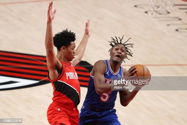 Immanuel Quickley of the New York Knicks drives against Anfernee Simons of the Portland Trail Blazers in the second quarter at Moda Center on January...