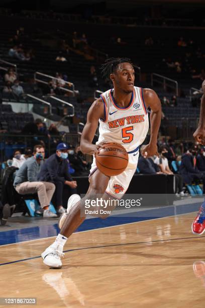 Immanuel Quickley of the New York Knicks handles the ball against the Philadelphia 76ers on March 21, 2021 at Madison Square Garden in New York City,...