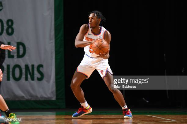 Immanuel Quickley of the New York Knicks handles the ball during the game against the Boston Celtics on January 17, 2021 at the TD Garden in Boston,...