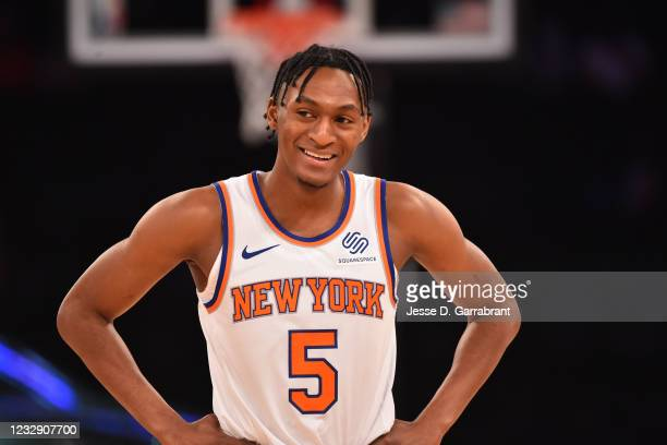 Immanuel Quickley of the New York Knicks looks on during the game against the Charlotte Hornets on May 15, 2021 at Madison Square Garden in New York...