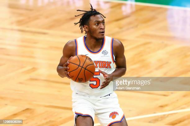 Immanuel Quickley of the New York Knicks looks to pass during a game against the Boston Celtics at TD Garden on January 17, 2021 in Boston,...