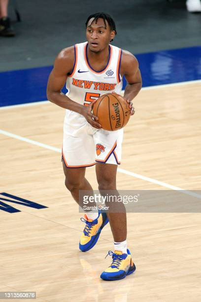 Immanuel Quickley of the New York Knicks looks to pass during the second half against the Charlotte Hornets at Madison Square Garden on April 20,...