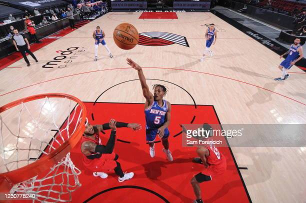 Immanuel Quickley of the New York Knicks shoots the ball during the game against the Portland Trail Blazers on January 24, 2021 at the Moda Center...