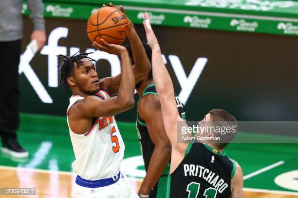 Immanuel Quickley of the New York Knicks shoots the ball over Payton Pritchard of the Boston Celtics during a game at TD Garden on January 17, 2021...