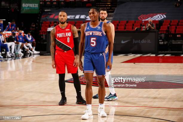 Immanuel Quickley of the New York Knicks smiles during the game against the Portland Trail Blazers on January 24, 2021 at the Moda Center Arena in...