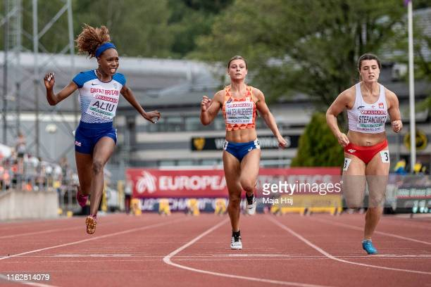 Immanuela Aliu of Great Britain crosses the finish line during 100m Women SemiFinals on July 18 2019 in Boras Sweden