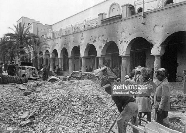 Immediately after the liberation of Benghazi debris are removed in front of the Palace of the Sisters of Ivrea Benghazi April 1941
