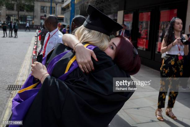 Immediately after their graduation ceremonies new graduates meet relatives and family outside the London School of Economics on 22nd July 2019 in...