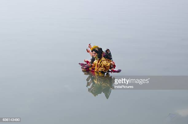 Immersed Hindu idol in Ganga river