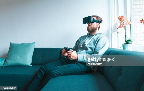 Immersive video game played by man wearing a virtual reality headset