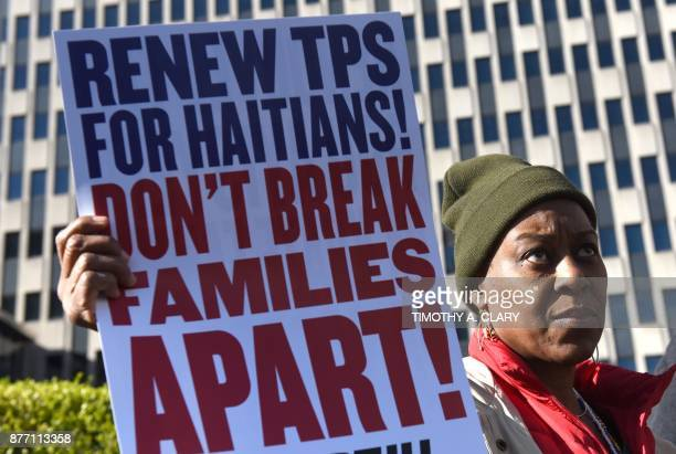Immigrant advocates rally against 'DHS decision to terminate TPS for Haitians' during a rally on November 21 2017 in New York to protest the decision...