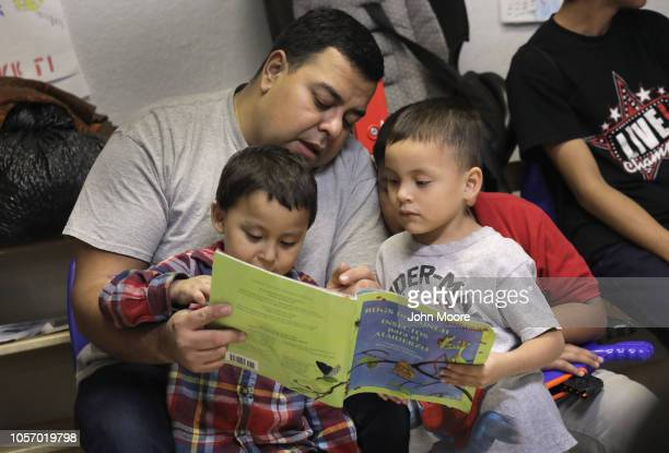 Immigrant children read at an aid center after being released from U.S. Government detention on November 3, 2018 in McAllen, Texas. U.S. Customs and...