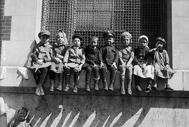 Immigrant Children Sitting on Window Ledge