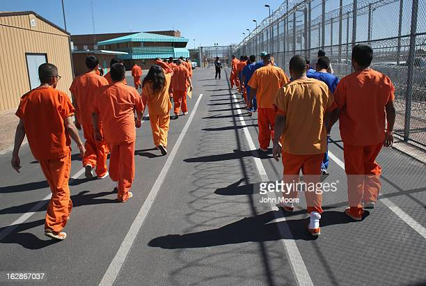 Immigrant detainees walk through the Immigration and Customs Enforcement , detention facility on February 28, 2013 in Florence, Arizona. With the...