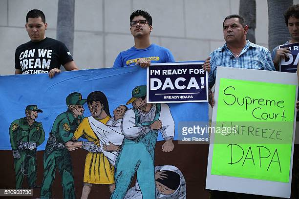Immigrant families and community members stand together during a press conference to speak about the Supreme Court Oral Arguments that are set to...