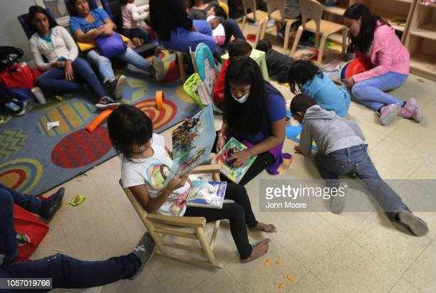 Immigrant families read and relax at an aid center after being released from U.S. Government detention on November 3, 2018 in McAllen, Texas. U.S....