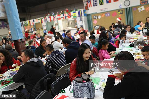 Immigrant families sit for dinner at a Family Night Christmas party at a community immigrant center on December 16 2016 in Stamford Connecticut More...