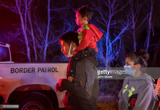 Immigrant families walk to a U.S. Border Patrol processing station after they crossed the Rio Grande from Mexico on April 29, 2021 in Roma, Texas. A...