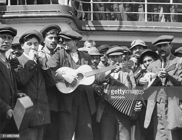 Immigrant form a makeshift band on shipboard during trip to America Photo by Lewis Hine